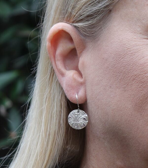 noosa-fine-silver-disc-earring-with-hibiscus-texture-85-00-by-julie-stephens-designs-fitzroy-126118-juliestephens