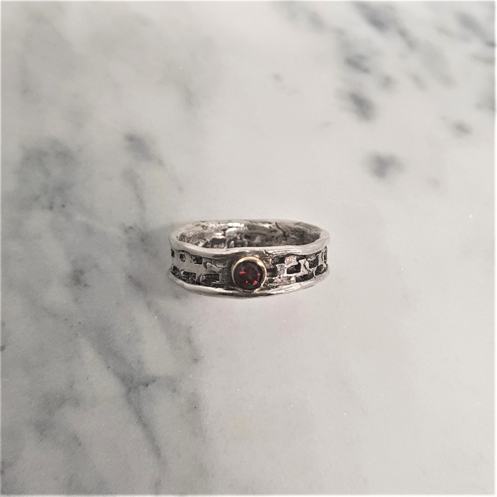 Textured Sterling Silver Ring With 3mm Pyrope Garnet Set In 9Ct Yellow Gold Rub Over Setting.Jewellery By Corinne Lomon