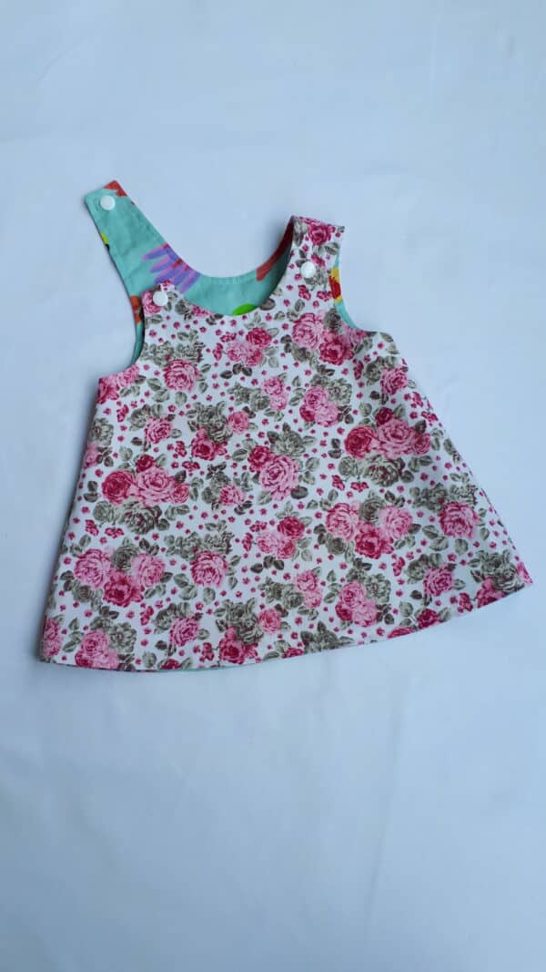 sz-0-pinafore-navy-floral-border-and-animal-faces-903254-kylie-8146