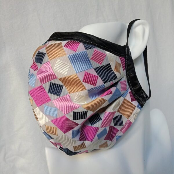 silk-facemask-featuring-pinks-in-a-multicoloured-geometric-weave-by-judith-scott-upcycling--judithscott