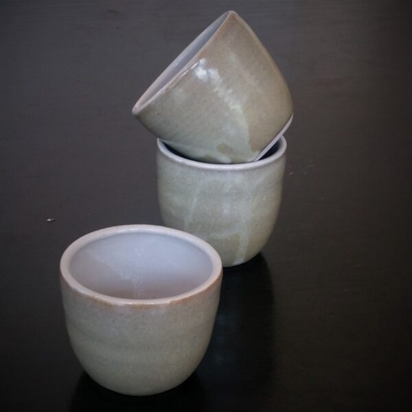 set-of-2-nested-gold-beakers-with-detail-by-clifton-hill-pottery-by-Clifton Hill Pottery
