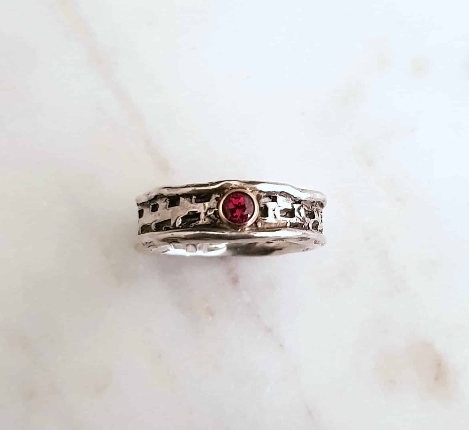 Textured Sterling Silver Ring With Garnet In Gold Stetting By Corinne Lomon