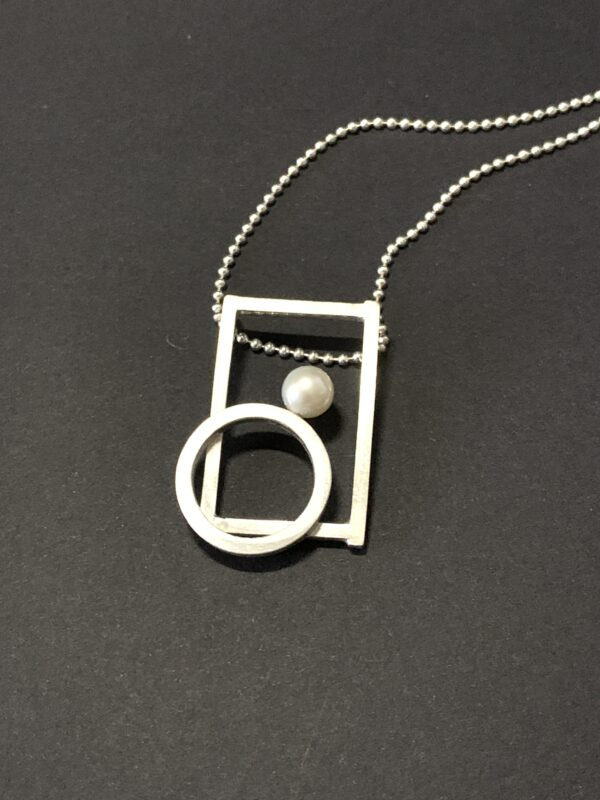 Very First Pearl Pendant Necklace by DORAMENDA