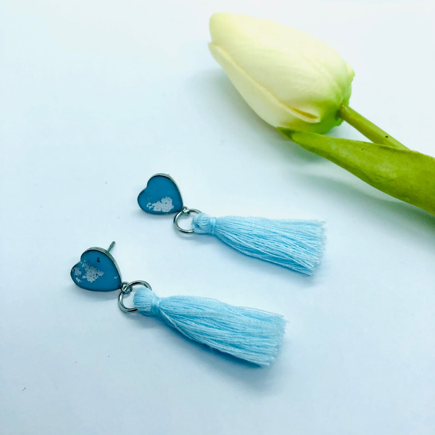 Pastel Blue Heart Earrings With Cotton Tassel – By Jantina