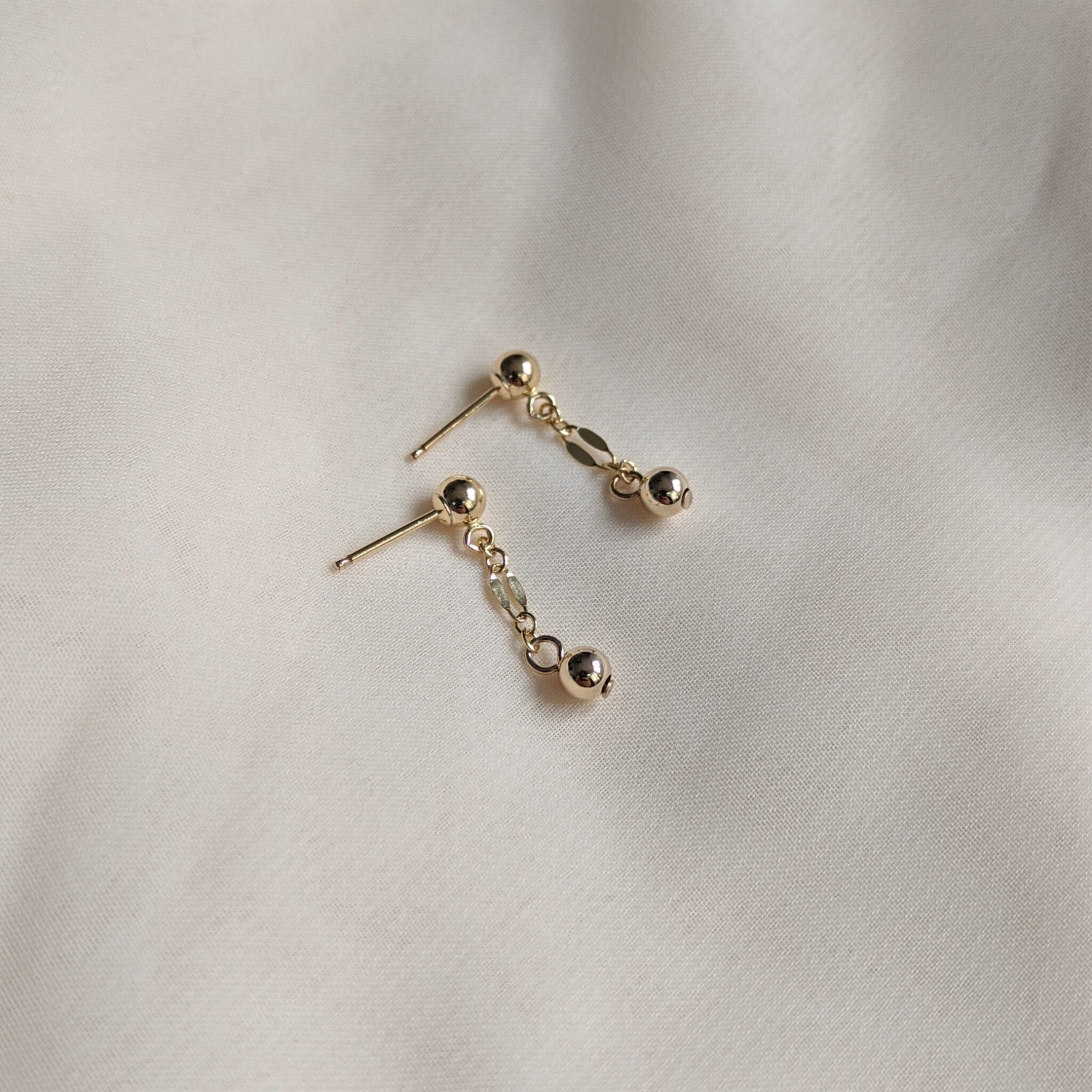 Two Bead Drop Stud Earrings In Gold Filled By Little Hangings