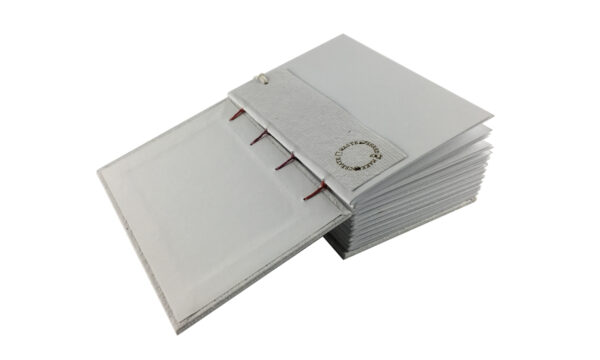 """""""Rainbow Spine"""" A6 Handmade Paper Journal by Zwartko Zwartko (Fitzroy)"""